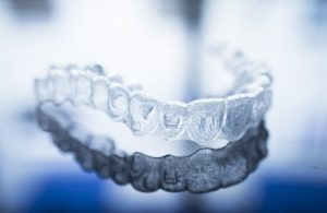 Invisalign-clear-aligners-laying-on-a-countertop
